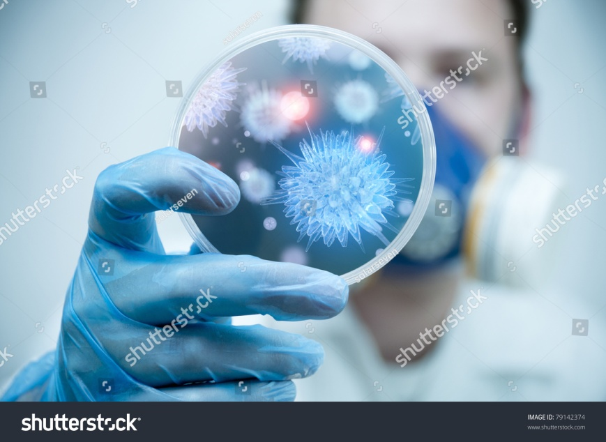 stock-photo-a-scientist-holding-a-petri-dish-with-virus-and-bacteria-cells-79142374