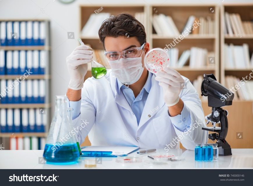 stock-photo-male-doctor-working-in-the-lab-on-virus-vaccine-740000146