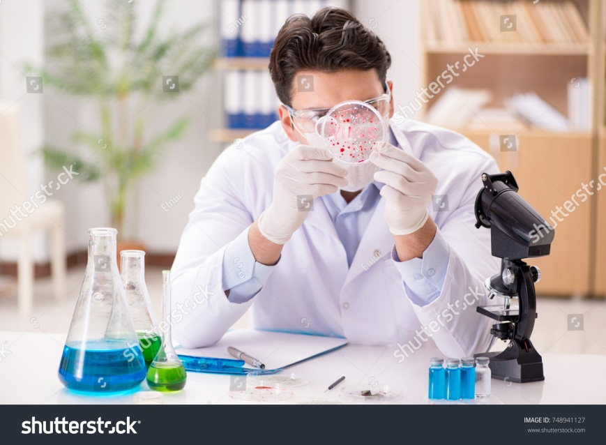 stock-photo-male-doctor-working-in-the-lab-on-virus-vaccine-748941127